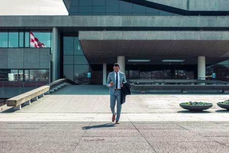 a businessman leaving an office