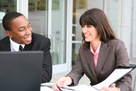 a man and a woman in suits having a meeting