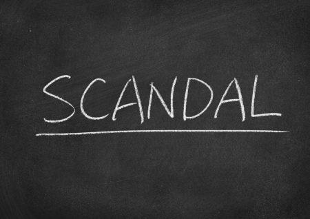 """The word """"SCANDAL"""" written on a chalkboard."""